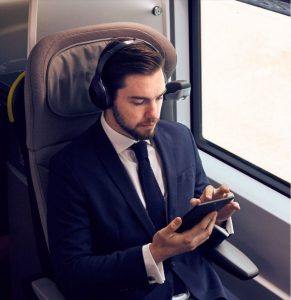Man on train looking at device